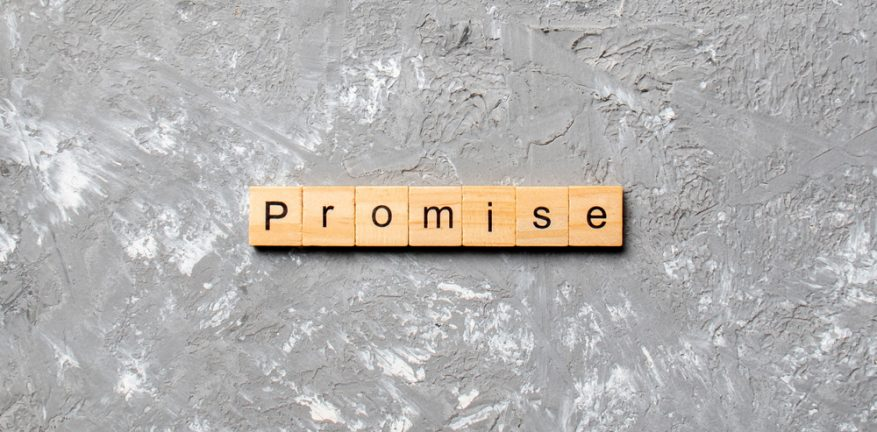 Word promise written on wooden tiles