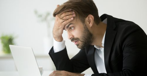 Worried Businessman at Computer
