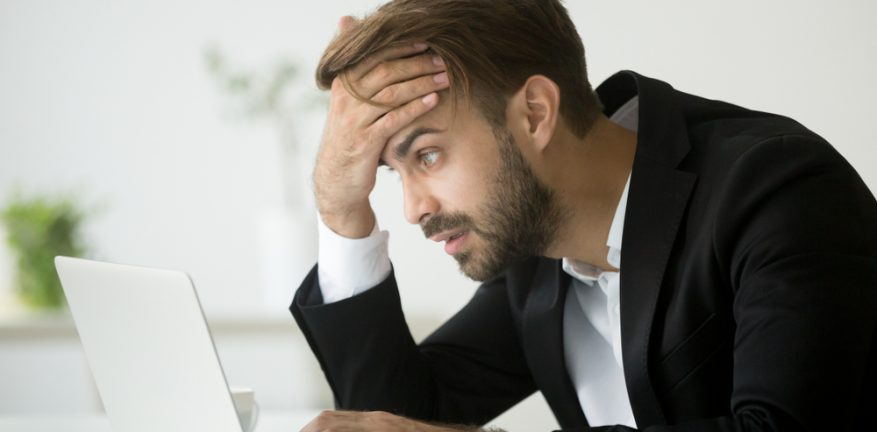 Worried Businessman at Computer