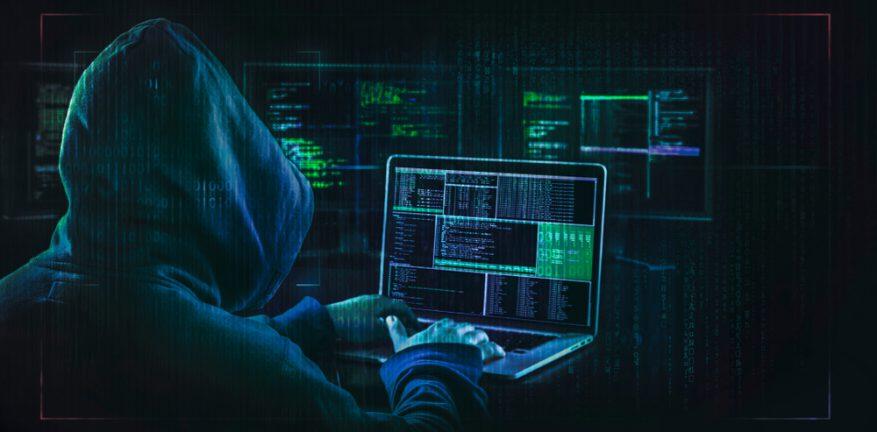 Hacker looking at computer
