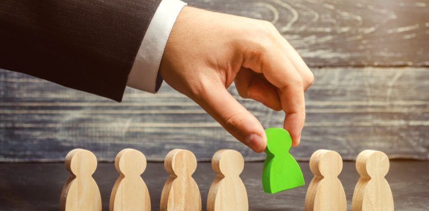 Businessman selecting a new hire from a group