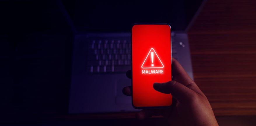malware symbol on a smartphone
