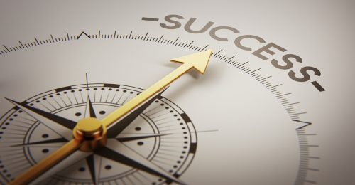 Compass pointing to word success