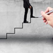 Businessman stepping up ladder
