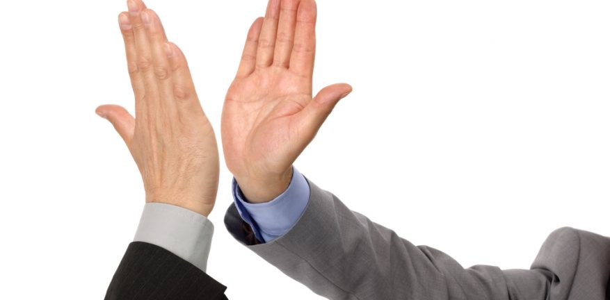 Businessman high-five