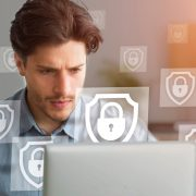 Man at computer with security icons