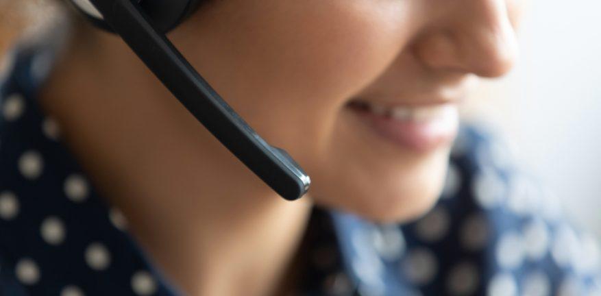 Close-up of call center agent