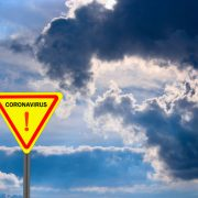 Coronavirus sign with clouds