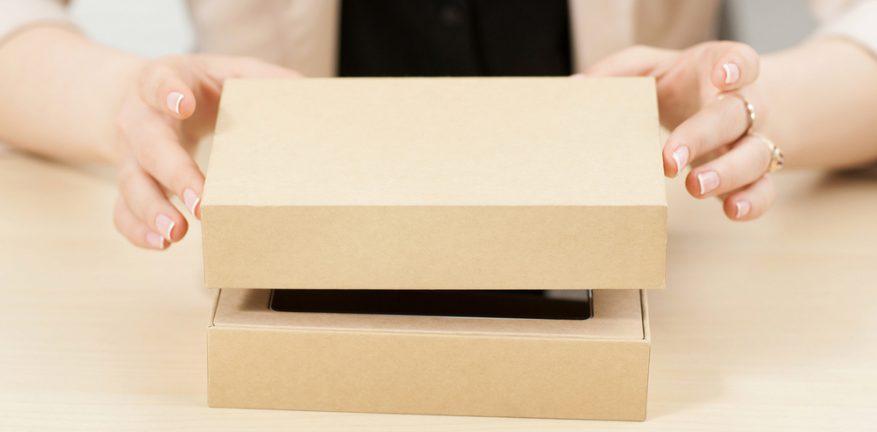 Woman lifts lid on box