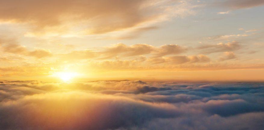 Cloud flare, sun over clouds