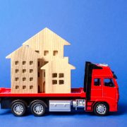 Toy truck moving toy buildings